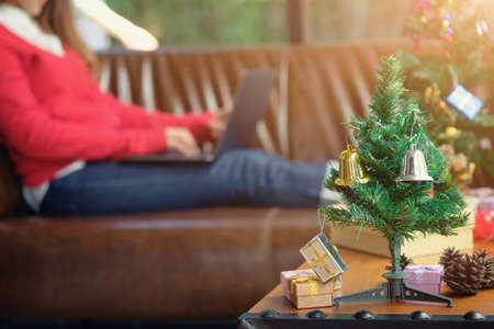 little Christmas tree on wooden desk with decoration ,festival concept.