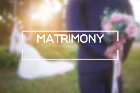 matrimony concept,matrimony text on background with man standing and woman.