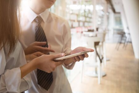Business meeting concept,two young businessmen using touchpad at meeting. Stock Photo