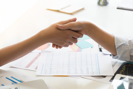 Business Partnership concept. Closeup business shaking hands finishing up a meeting,acquisition concept. Stock Photo