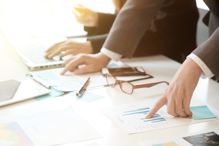 business analysis hands pointing data paper and consulting with closeup.
