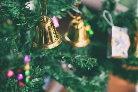 Christmas bell decorative on tree with closeup.