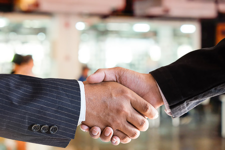 Cropped shot of closeup Acquisition Business Partnership shaking hands finishing up a meeting.
