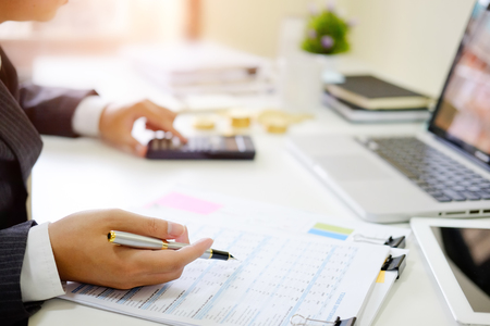 Finance control close up hand analysis financial data in document paper. Foto de archivo