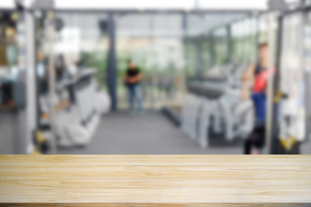 Wood table is empty in fitness gym.