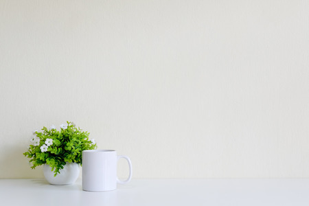 Workspace with coffee cup and tree decoration