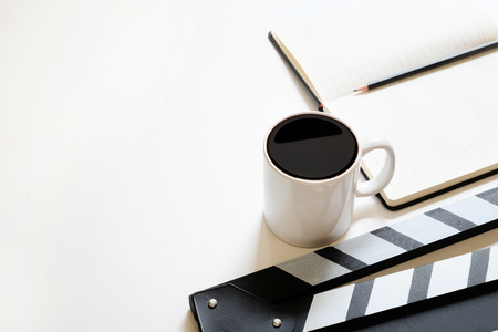 Office stuff with Movie clapper and coffee cup pencil notepad on table top view shot and copy space. Stok Fotoğraf