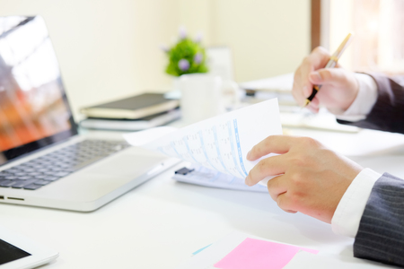 Finance control close up hand analysis financial data in document paper. Stock Photo