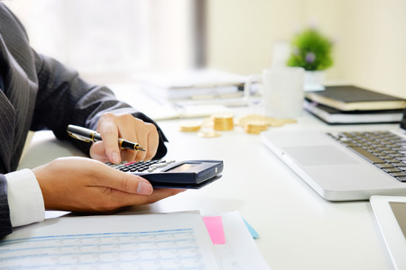 Close up business calculate finance data document paper with calculator. Stock Photo