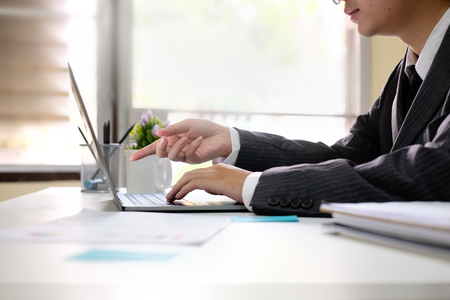 Businessman working with laptop computer in home office. Stock Photo