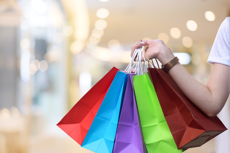 Close up woman hands carry a shopping bag in shopping mall. Stock Photo