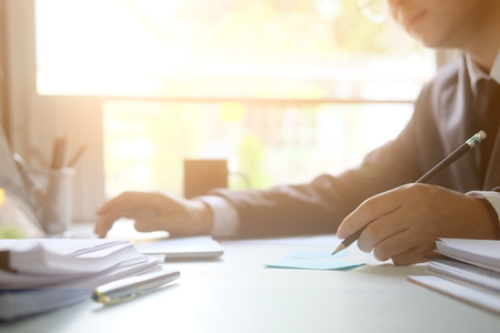 Businessman analysis data working on table with morning light. Stock Photo