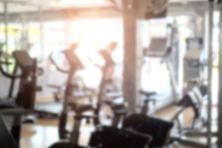 Blur fitness room sport training background.