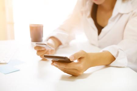 Female shopping online on smartphone.