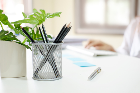 jar of pencil on business office table.