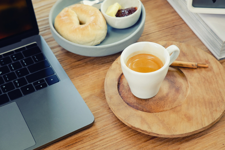 coffee break  cup of espresso on working business wood table. Stock Photo