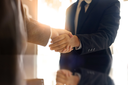 Business partnership handshake concept.Photo two coworkers handshaking process.Successful deal or acquisition after great meeting.