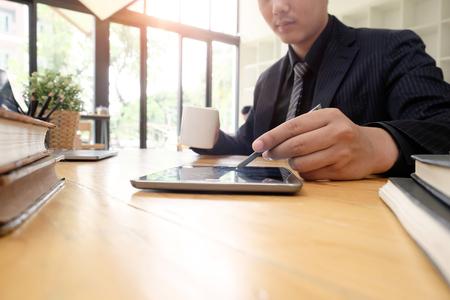 Businessman investor working new startup project. Finance on Digital tablet laptop computer, Audit man working with digital data.