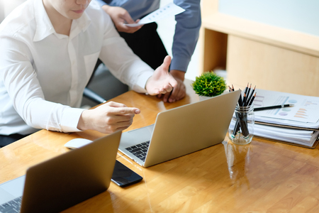 Asian Business partner working with laptop, Two colleagues discussion with business consult. Stock Photo