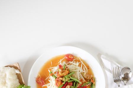 Som tam thai, green papaya salad on white table with space. Stock Photo