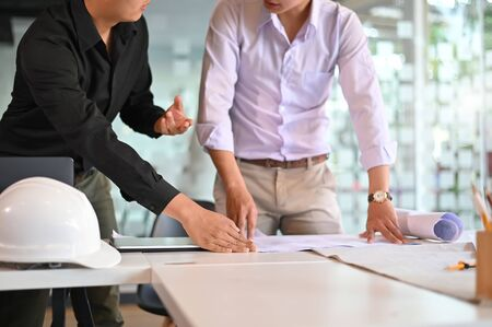 Engineer planing and Architecture working achievement Planning Design Draw teamwork of architecture meeting.