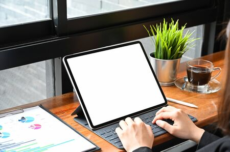Business woman using mockup tablet with finance paper, Close up shot.