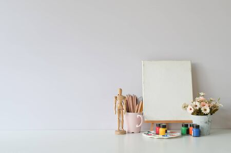 Office creative table with supplies and white wall. Stok Fotoğraf