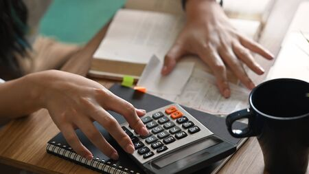 Home finance concept, Close-up woman calculating paying utility bills.