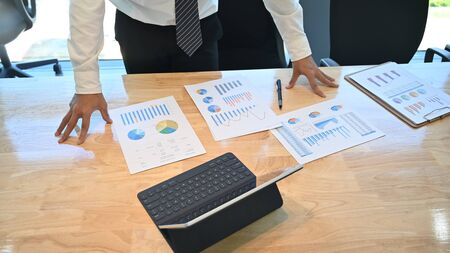 Top view business compare data chart paper on office desk.