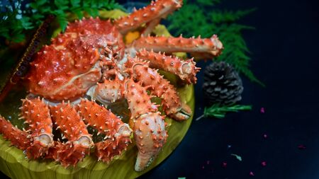 Red King Crab Japanese food on black table, selective focus. Stockfoto
