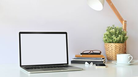 ฺBlank screen laptop and office equipment is on the table. Modern working desk concept.