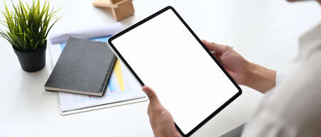 Young business woman using tablet with white screen
