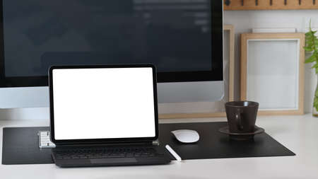 Modern workspace with computer, smart phone, and office supplies on white table. Stock fotó