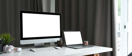 Modern dark workspace with black equipment and copy space on black leather.