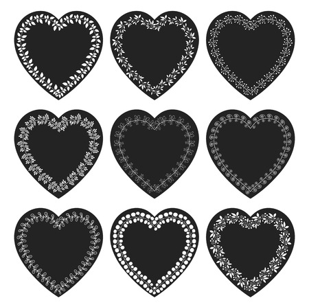 Set with black heart shaped tags with white floral borders in chalkboard style for labels, tags and product packaging Illustration