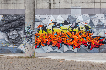 UDINE, ITALY DECEMBER 31, 2017 Beautiful street art graffiti abstract creative drawing fashion colors on the walls of the city
