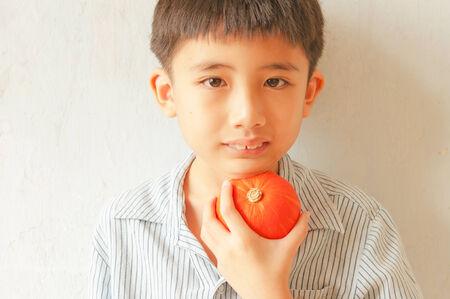 citrus family: portrait of Asian little boy