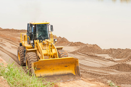 Front end loader working on the waterfront. Stock Photo