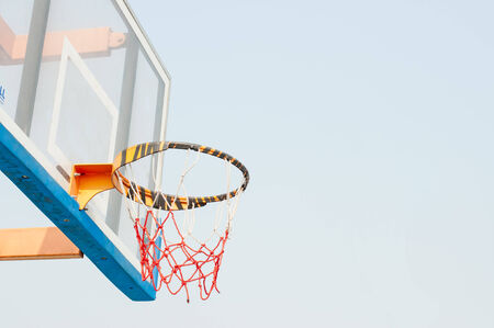 Closeup of basketball hoop with space for your text