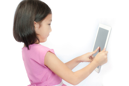 Little girl with touch pad computer, Isolated on white