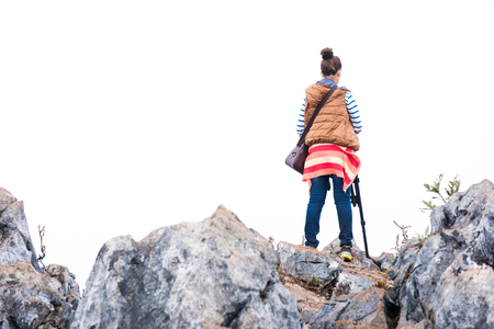 Woman photographer climbing the mountain Stock Photo