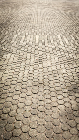 patterned paving tiles, cement brick floor background photo