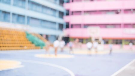 fun day: photo blur of student playing sports in school