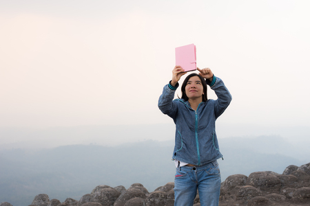 photo story: young woman selfie during Sunset on mountain with landscape view
