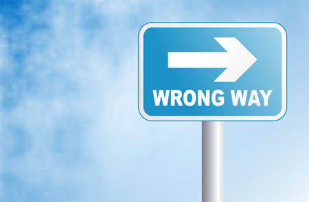 wrong way: wrong way sign against a sky background Stock Photo