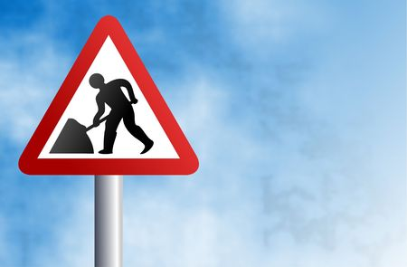 roadworks: warning road works in progress sign against a sky background