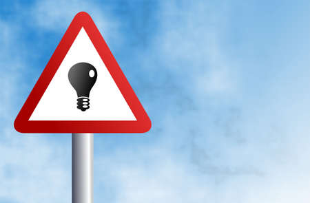 communicaton: warning sign with lightbulb icon against a sky background