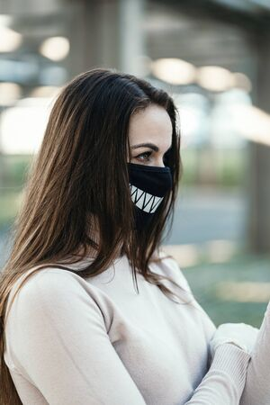 Young girl in funny medical mask and gloves