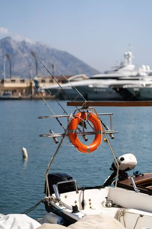 The lifeline is mounted on a motorboat. Fishing rods Banco de Imagens