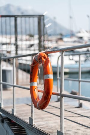 Orange rescue circle at the Yacht Club Rescue buoy